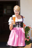 Young woman in dirndl with white beer — Stock Photo