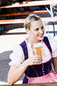 Bavarian woman in the beer garden — Stock Photo