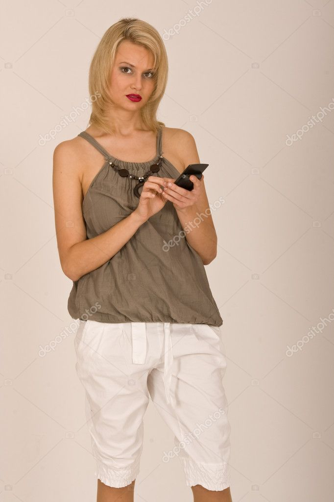 Woman typing on a mobile phone — Stock Photo #6612651