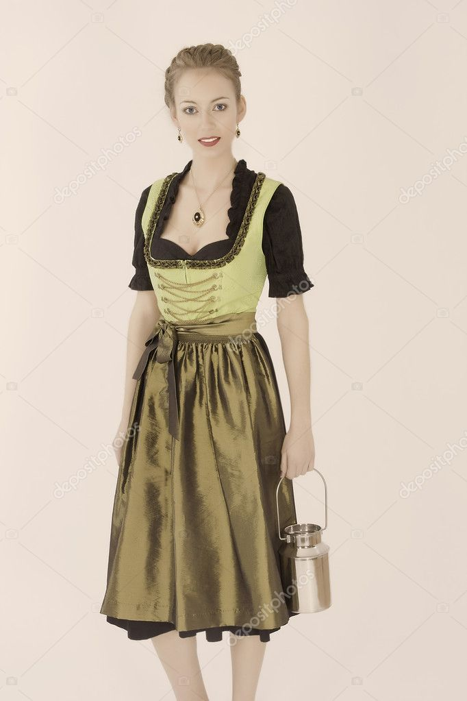 Bavarian girl in traditional dress with a milk jug in her hand — Stock Photo #6612691