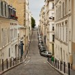Stock Photo: Narrow street in Monmartre in gloomy day