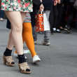 Women legs in crowd - Stock Photo