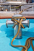 Metal bollard with rope at a ship deck — Stock Photo