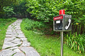 Emergency telephone in the park — Stock Photo