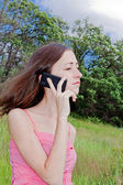 Woman speaking the phone — Stockfoto