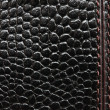 Macro picture of black leather with stitches — Stockfoto