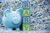 Baby with Blue Piggy Bank — Stockfoto