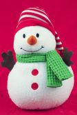 Bonhomme de neige jouet sur rouge — Photo