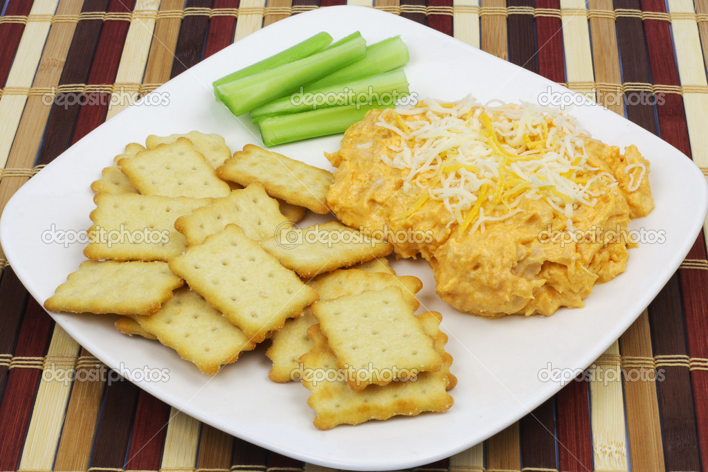 Appetizer buffalo chicken dip with crackers and celery — Stock Photo #5612411