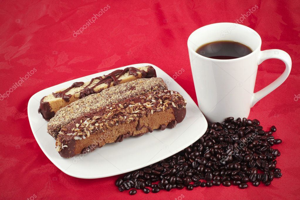Coffee and Biscotti on a red textured background — Stock Photo #5612422