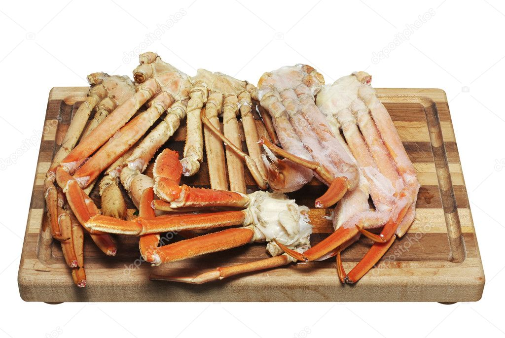 Crab legs on a cutting board isolated on white — Stock Photo #5612430