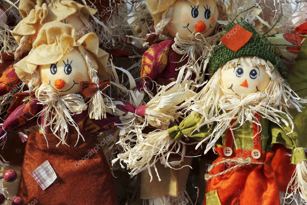 A colorful arrangement of Halloween scarecrow dolls welcome the fall autumn season — Stock Photo #5612454