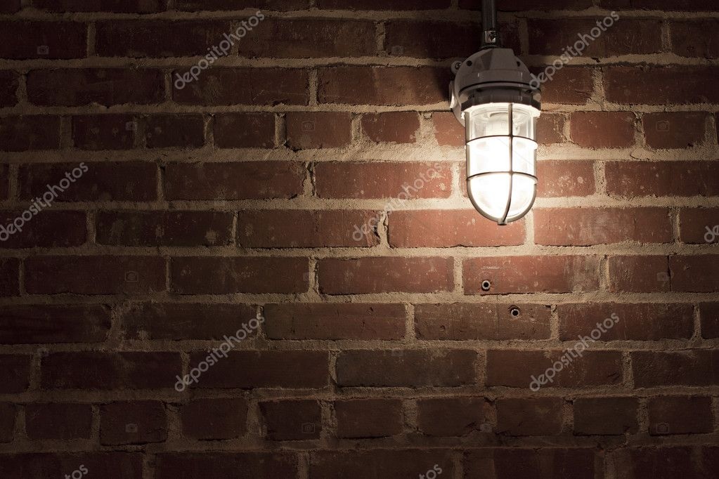 Creepy light bulb on textured red brick wall — Stock Photo #6518210
