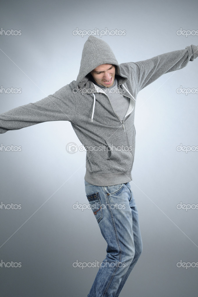 Pretty white male practicing dance movements in studio  Stock Photo #5542861