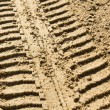 Tire tracks in sand — Stock Photo