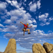 Climber jumping across gap. — Stock Photo
