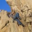 Rock climber dangling. - Stock Photo