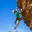 ������, ������: Male rock climber reaching for the summit