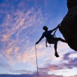 Rock climber rappelling. — Stock Photo #5584403