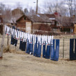 Clothesline and drying  clothes. - Zdjcie stockowe