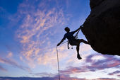 Rock climber rappelling. — Photo