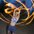 Fire spinning, hoop dancer, performing. — Стоковое фото