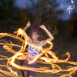 Fire spinning, hoop dancer, performing. - Stok fotoğraf