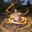 Fire spinning, hoop dancer, performing. — Stock fotografie #5600601