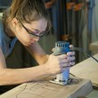 Young woman cabinet making. — Stock Photo