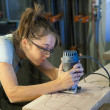Young woman cabinet making. - Stock Photo