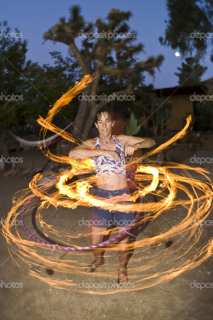 Hoop dancer performing with a fire-hoop, the hoop has six lighted wicks on the outside edge. — Stock Photo #5600601