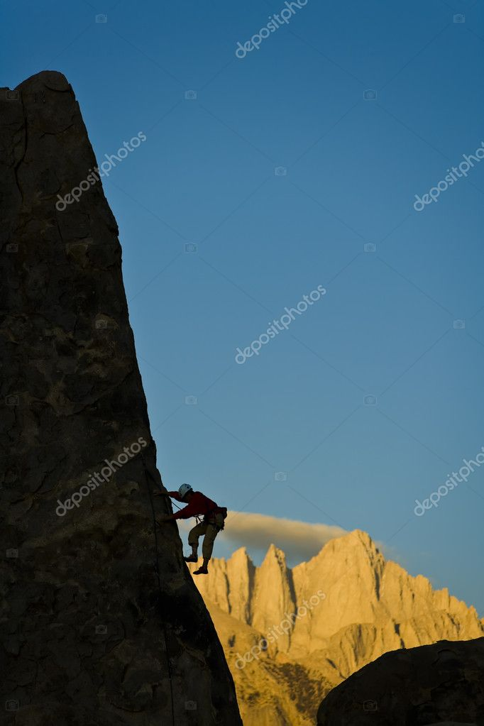Climber asscending the sheer edge of a pinnacle in The Sierra Nevada Mountains, California, on a summer day.  Stock Photo #5603964