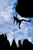 Climber dangling from a rope. — Stock Photo