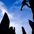 Climber ascending a rock spire — Stock Photo #5648229