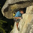 Rock climber struggelling up a crack. - 