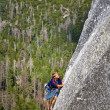 Stock Photo: Climber ascending difficult crack.