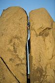 Rock climbing a split pillar. — Stock Photo