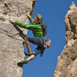 Female rock climber. - Stock Photo