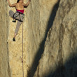 Female rock climber. - Stockfoto