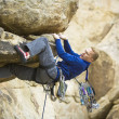 Rock climber clinging to a cliff. — Stock Photo #5750693