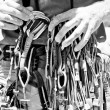 Climber organizing equipment. - Stock Photo