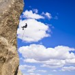 Rock climber rappelling. — Stock Photo #5750833