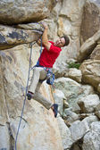 Rock climber dangling from a cliff. — Stock Photo