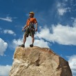 Rock climber nearing the summit. — Stock Photo