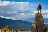 Rock climber nearing the summit. — Stock Photo