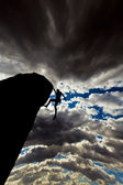 Climber clinging to a cliff. — Stock Photo