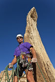 Male rock climber on the summit. — Stock Photo