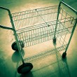 Stock Photo: Wire basket wheeled cart.