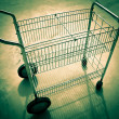 Wire basket wheeled cart. - Photo