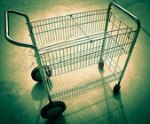 Wire basket wheeled cart. — Stock Photo